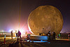 installing the giant inflatable moon - burning man 2012, burning man, inflatable moon, lune and tide, night, silhouettes