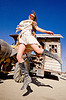 elena kulikova - burning man 2012, boots, burning man, elena, jump, jumpshot, red sunglasses