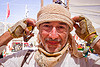 philippe glade, bandana, burning man, gloves, hat, open finger mittens, philippe glade, unshaven man