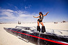woman dancing on rocket car - burning man 2012, art car, black leg warmers, burning man, dancing, furry leg warmers, long, rocket car, woman