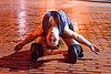 contortionist, back stretching, brick floor, brick tiles, contortionist, justin herman plaza, night, stretch, woman