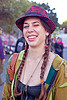 red lacey hat, braid, braided hair, burning man decompression, earrings, lacey hat, lauren, red hat, woman