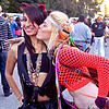 girl kissing girl on the cheek, audreya, blonde, brunette, burning man decompression, cat ears hair band, devin, fashion, fishnet top, necklaces, neklace, people, piercing, ravers, ribbons, women