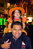 little girl in witch costume, child, daughter, day of the dead, dia de los muertos, father, halloween, kid, latino, little girl, man, night, orange color, witch costume, witch hat