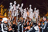 dancing skeleton puppets, crowd, dancing skeletons, day of the dead, dia de los muertos, halloween, music, musicians, night, paper skeleton puppets, paper skeletons, procession, street