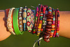friendship bands and bracelets, alexis, arm, close-up, friendship bands, friendship bracelets, girl, hippie bracelets, jewelry, many, rubber band, rubber bracelet, seeds, woman, wooden beads, wrist, youth fashion