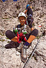 kid with climbing gear, alps, climbers, climbing harness, climbing helmet, dolomites, dolomiti, girl, hiking boots, mona, mountain climbing, mountaineer, mountaineering, mountains, people, rock climbing, steel cable, teen, teenager, via ferrata