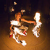 woman dancing with fire fans - cressie mae