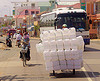 oversize load - plastic cans on tricycle - tricycle - vietnam, cargo tricycle, cargo trike, commerce, cycle rickshaw, freight tricycle, freight trike, jerrycans, oversize load, people, plastic cans, plastic containers, road, street, traffic