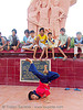 kids break-dancing in front of communist monument - vietnam, boys, break dance, break dancing, children, communism, communist, kids, memorial, monument, phan thiet, victory