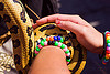 pet python snake coiling around arm, arm, beads bracelets, coiled, coiling, gay pride festival, hands, holding, kandi bracelets, pet snake, python snake, reptile, wrist