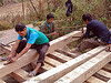 carpenters working on wood beams - vietnam, carpenters, construction workers, home builders, house, men, tools, wood beams, wood saw, working