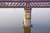 truss bridge pillar on ganges river (india), advertising, bridge pillar, ganga river, ganges river, metal bridge, painted ad, truss bridge, water