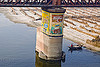 bridge pillar in ganga river - murli tea painted ad (india), advertising, agriculture, bridge pillar, floodplain, ganga river, ganges river, metal bridge, murli tea, painted ad, river boat, riverbed, rowing boat, sand, small boat, truss bridge, water