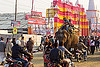 elephant riding in street traffic - kumbh mela 2013 (india), ashram, asian elephant, crowd, elephant riding, hindu, hinduism, kumbha mela, maha kumbh mela, mahout, man, motorbikes, motorcycles, street, traffic