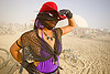 woman with red hat in white out (dust storm) - burning man 2013, black gloves, black lace, burning man, dust storm, mask, necklace, purple, red hat, sunglasses, white out, woman