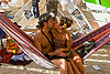couple kissing on hammock in temple - burning man 2013, burning man, couple, hammock, inside, interior, kiss, kissing, lovers, making out, mementos, temple of whollyness, woman