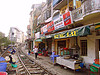 restaurant with view on the train track - vietnam, hanoi, houses, hung lau, hưng lâu, metric gauge, narrow gauge, rail tracks, railroad tracks, rails, railway tracks, restaurant, single track, street, train tracks